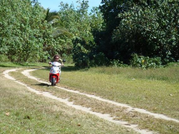 Simon mopeding around Aitutaki