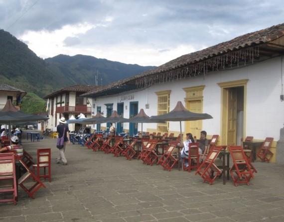 Cafes line Jardin's plaza, Colombia