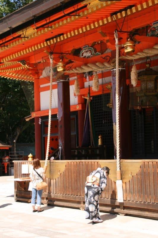 Praying at Yasaka-jinja