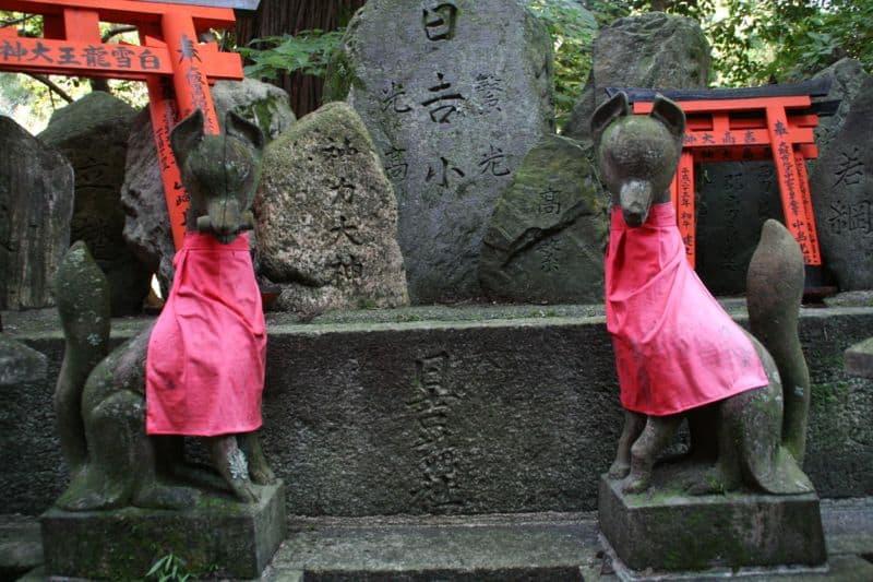 Guardian foxes at Fushimi Inari Shrine, Kyoto
