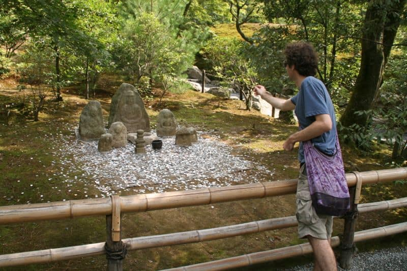 Simon throwing money at the Golden Temple, Kyoto