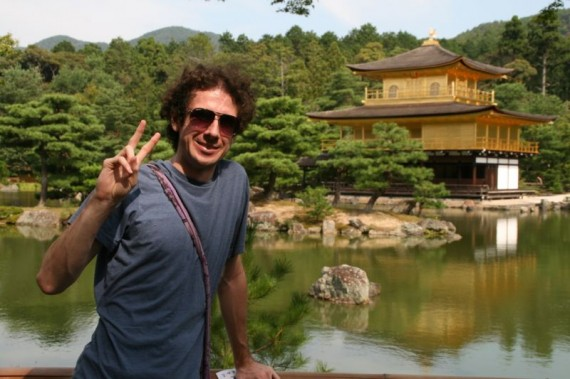 Simon making a peace sign at Golden Temple, Kyoto