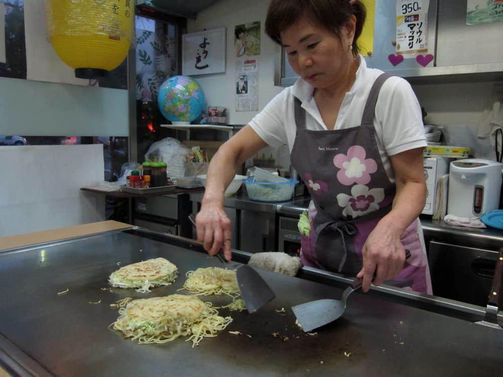 Okonomiyaki being made at Rie, Hiroshima