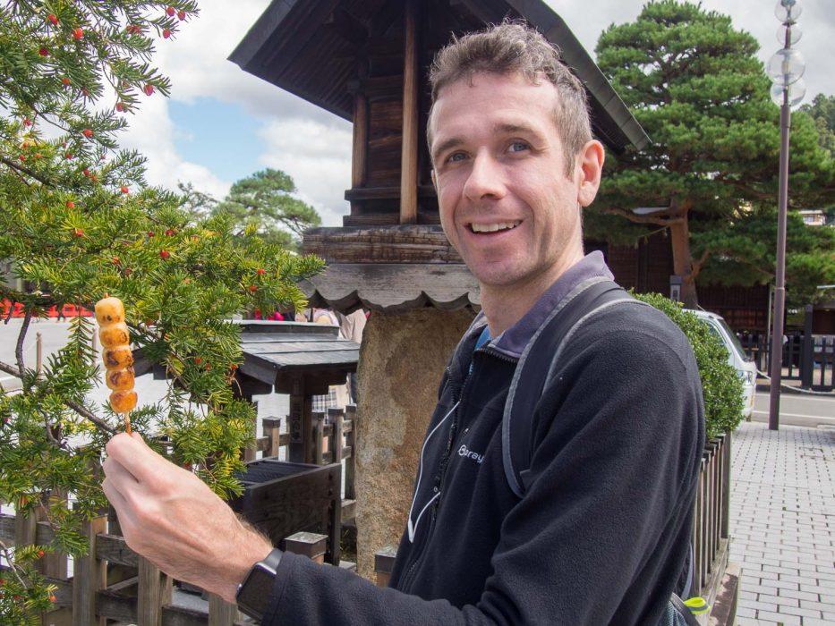 Mitarashi dango - a vegetarian Japanese food served on the street in Takayama, Japan