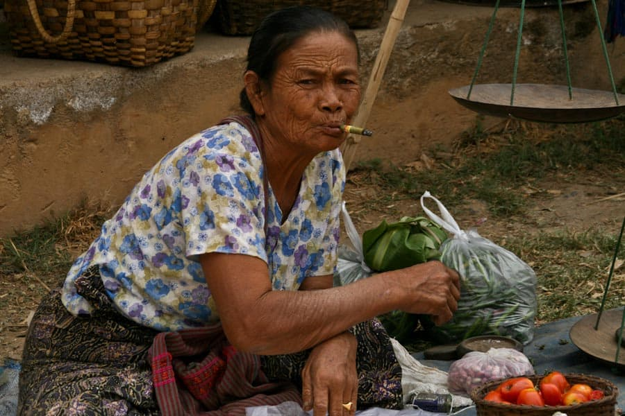 Market vendor smoking a cheroot, Burma