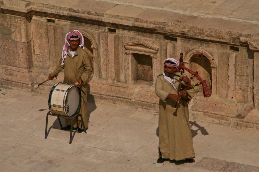 Bagpipers at Jerash in traditional Jordanian men's tunic and kaffiyeh