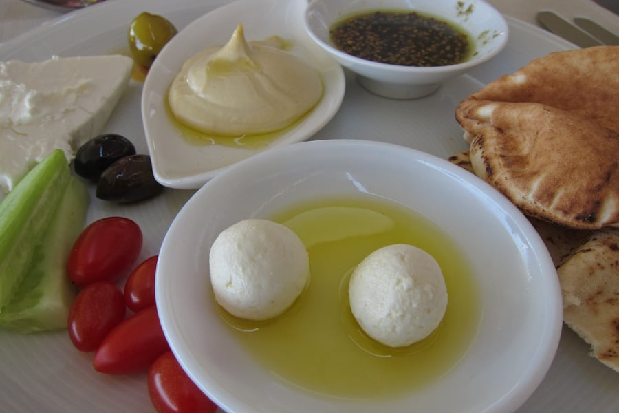 Labneh balls at the front with other Jordanian breakfast dishes