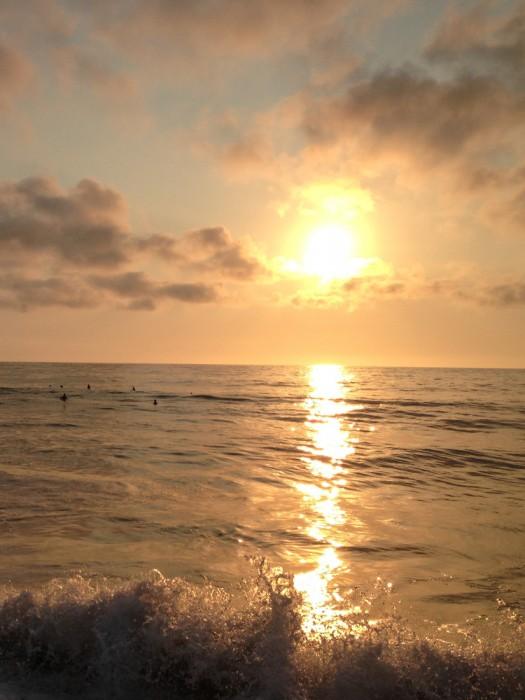 Surfers at sunset in San Pancho
