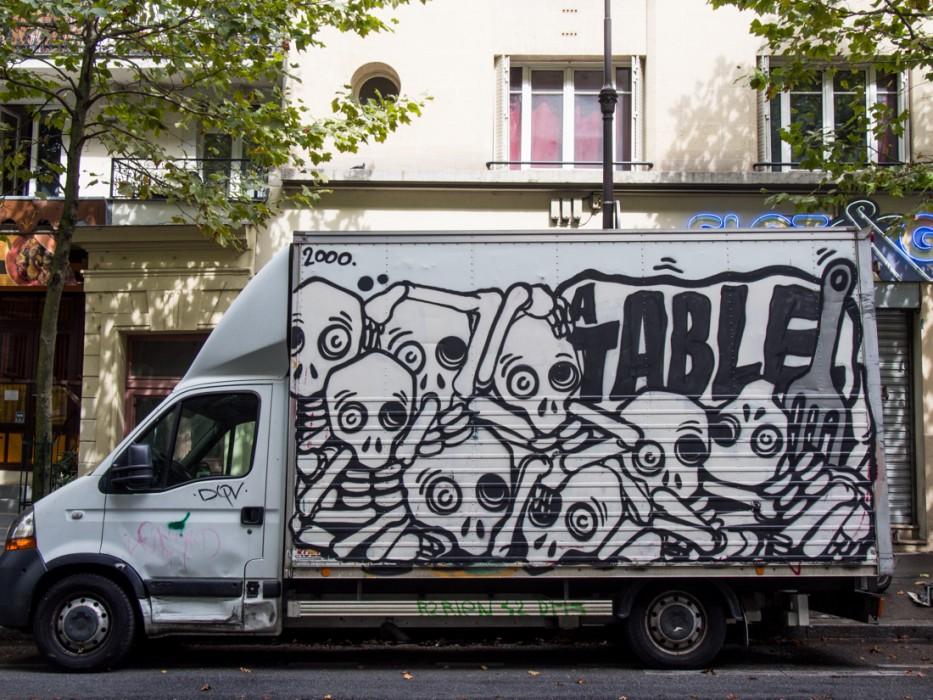 Even the delivery trucks in Paris are covered in graffiti