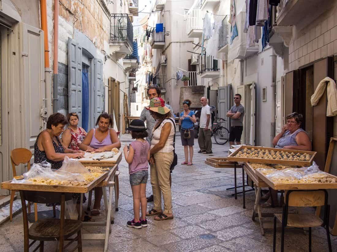 Women making orecchiette pasta on the streets of Bari, Puglia