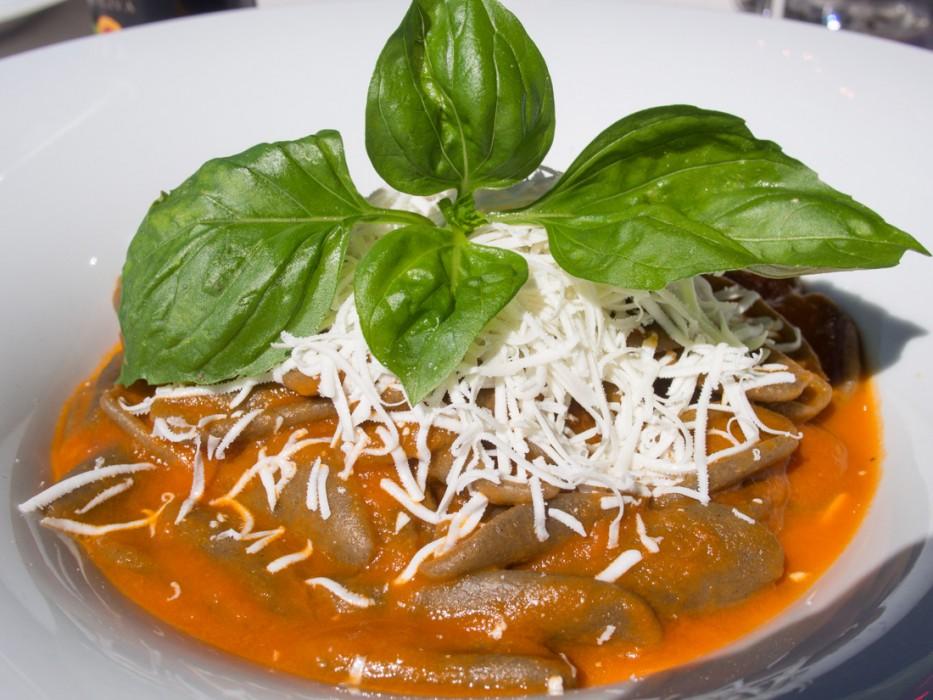 Dark orecchiette with tomato and caciocavallo cheese at Ristorante Porta Nova in Ostuni