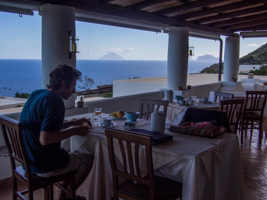 The breakfast terrace at Hotel Principe di Salina with views of Stromboli and Panarea