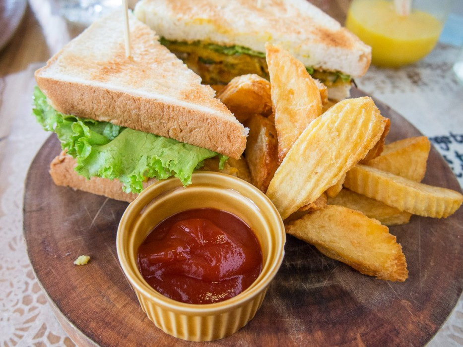 Vegetarian club sandwich and chunky chips at Sister Srey