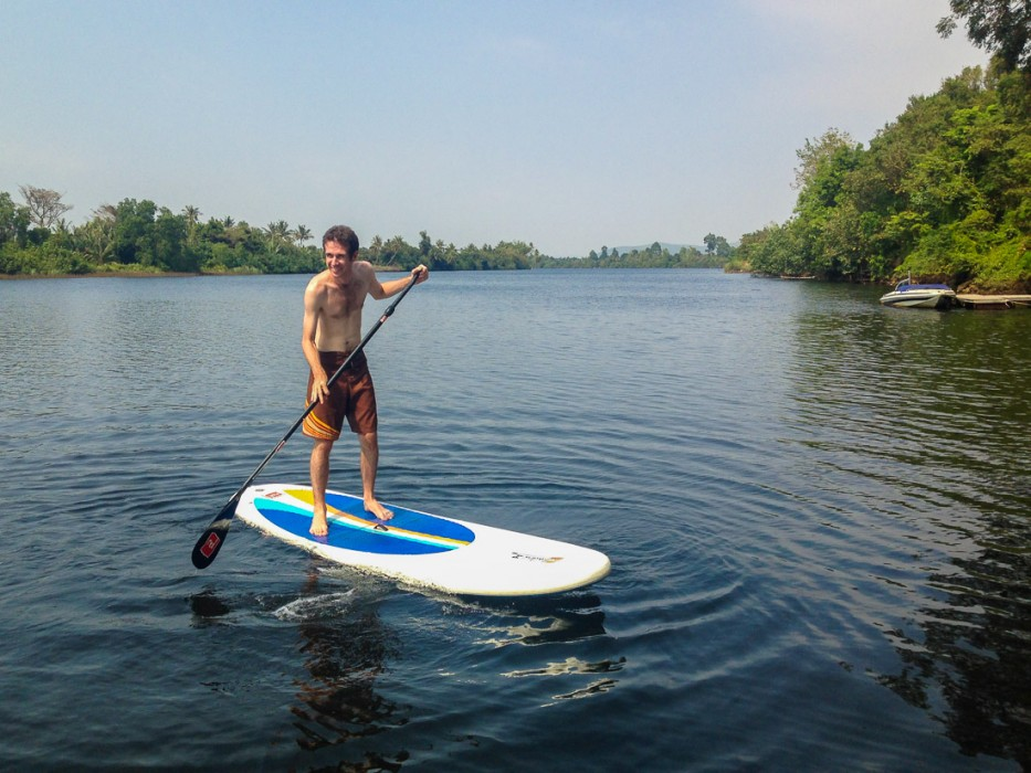 Simon stand up paddle boarding at GreenHouse