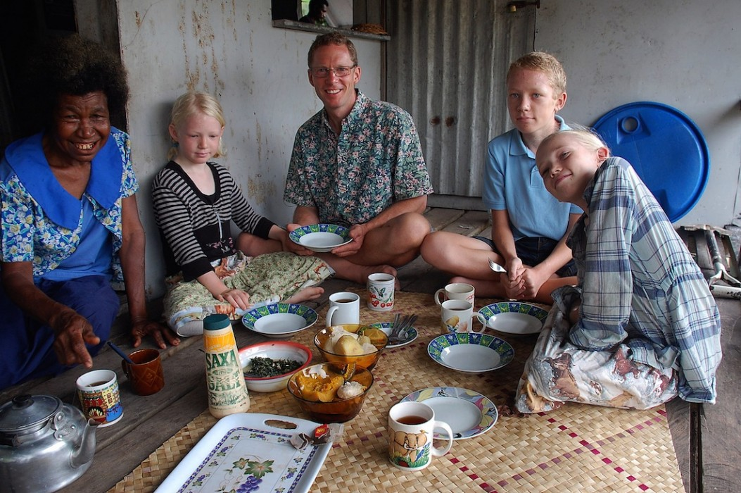 Invited to a meal with new friends; Panapompom island, Papua New Guinea