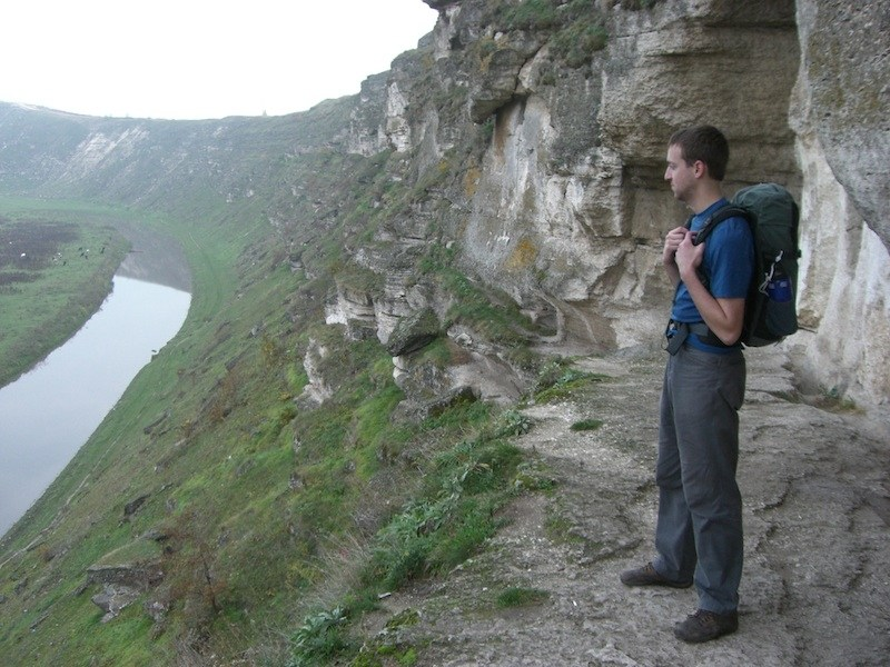 Eytan with his carry-on backpack at Orheiul Vechi-Canyon in Moldova
