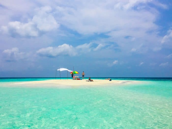 Learn how to plan a trip to the Maldives on a budget. A snorkelling trip in Maafushi including lunch on this sandbank only cost $25!