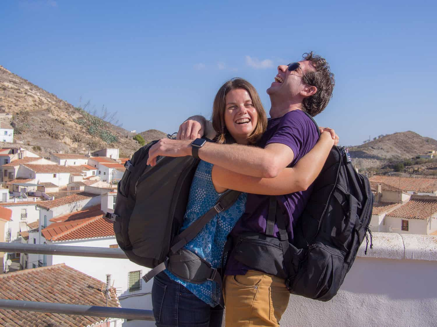 Erin and Simon with carry on backpacks in Lubrin, Spain