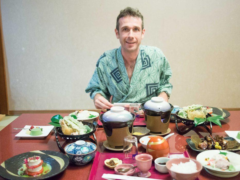 Simon wearing a yukata and enjoying our vegetarian feast in our ryokan room in Hakone