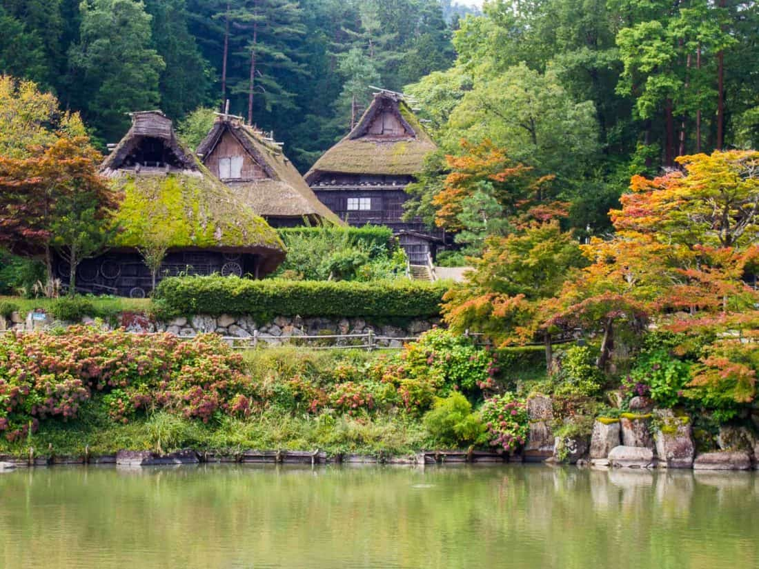 Traditional grass roof houses at the Hida Folk Village in Takayama with autumn colours