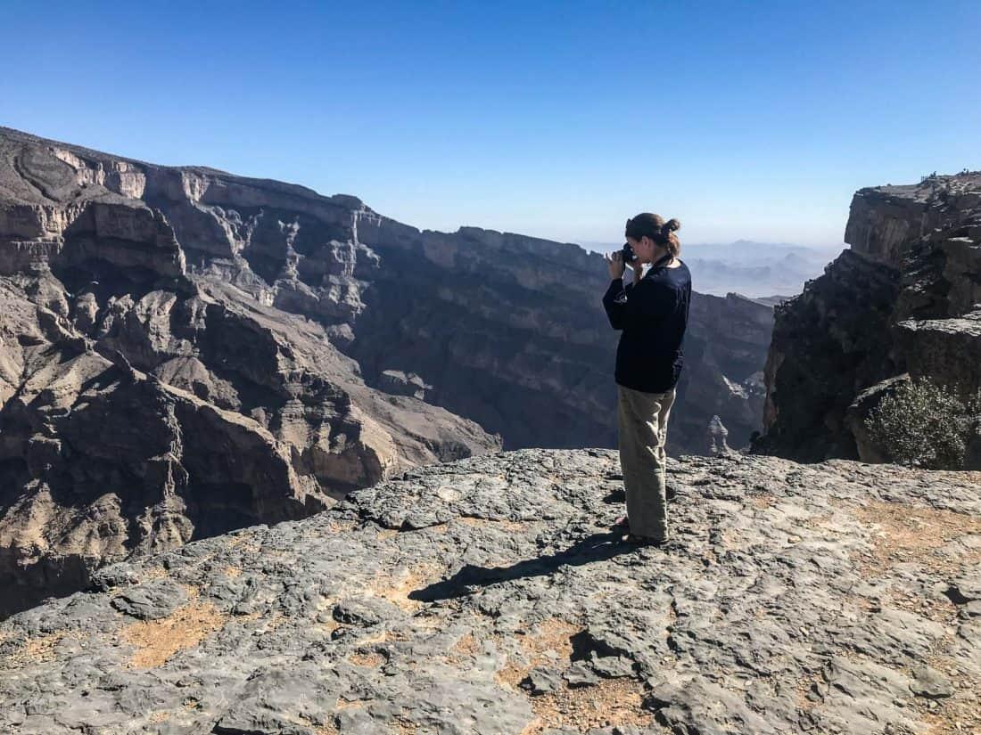 Erin taking photos at Jebel Shams