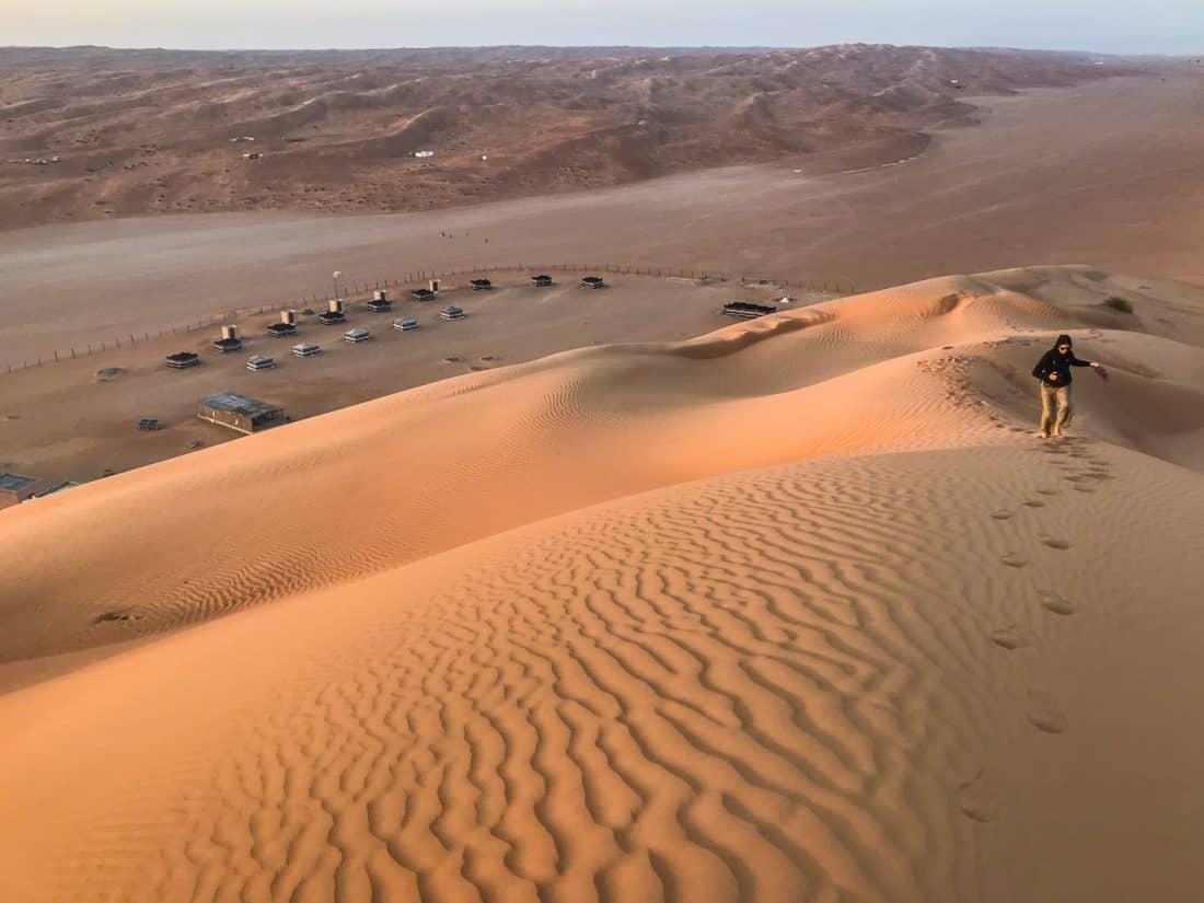 Hiking up the sand dune next to Desert Retreat Camp, Wahiba Sands, Oman
