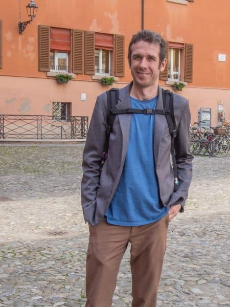 Simon in Modena wearing the Bluffworks blazer with a t-shirt and Bluffworks original pants