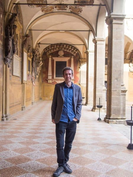Simon in Bologna wearing the Bluffworks blazer with the Bluffworks shirt and black jeans