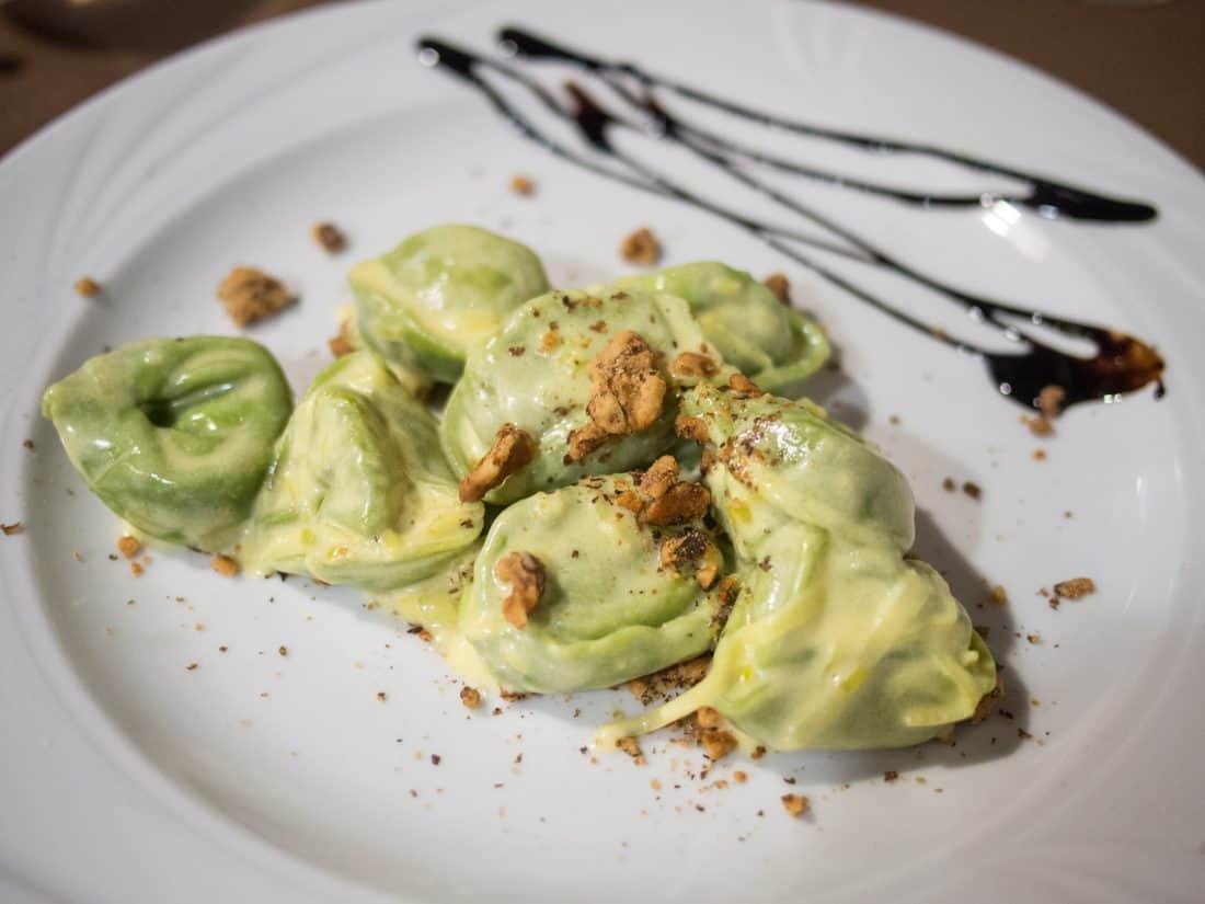 Green tortelloni with a walnut and saffron sauce at Trattoria Del Rosso in Bologna
