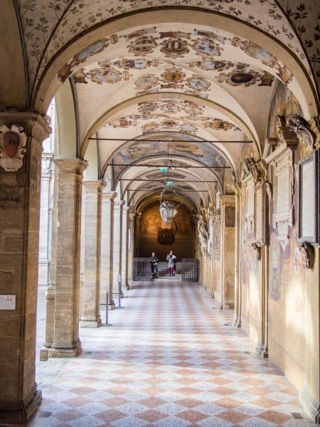 The gorgeous fresco covered porticos in the courtyard of the Archiginasio, Bologna University