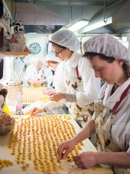 Tortellini pasta makers in Bologna, Italy