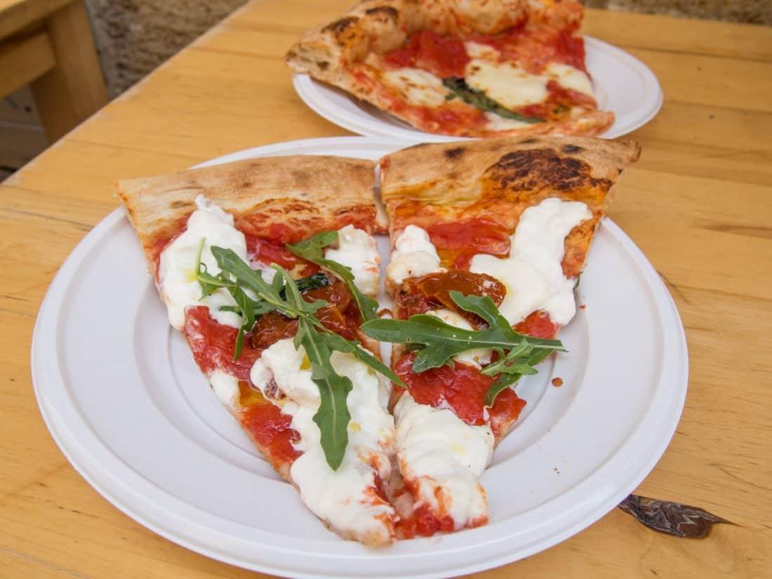 Buratta pizza and Margherita pizza slices at Pizza & Co in Lecce, Puglia