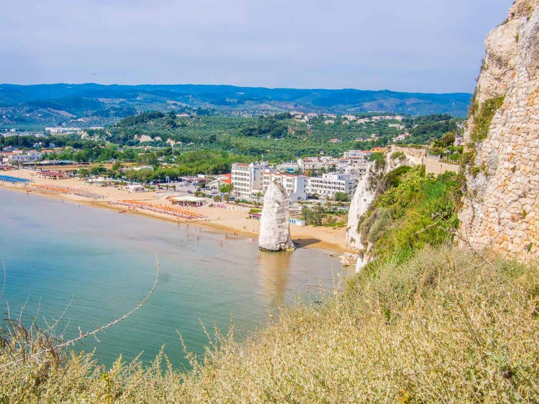 View of Castello Beach and the Pizzomunno rock from the castle in Vieste Italy