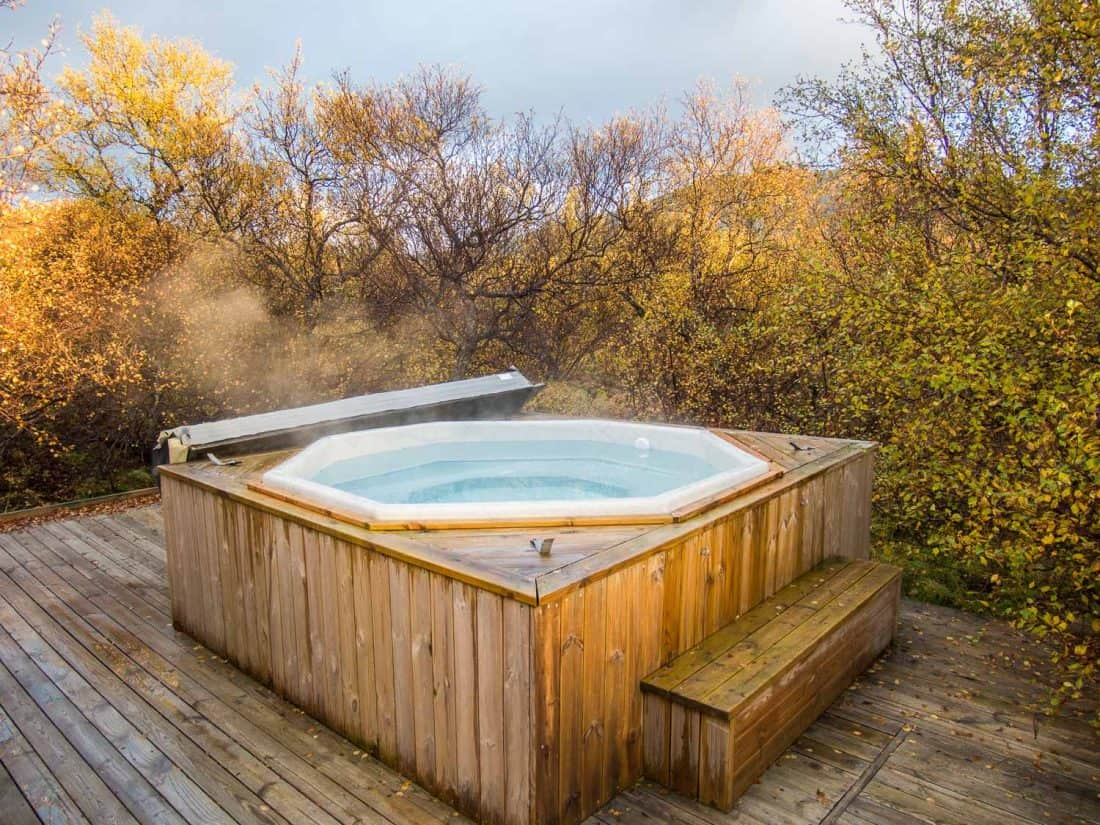 The hot tub at our Airbnb cabin in Husafell, Iceland