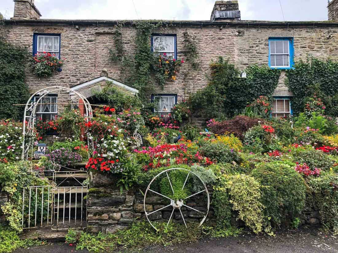 Flower covered cottages in Millthrop village on the Dales Way hike