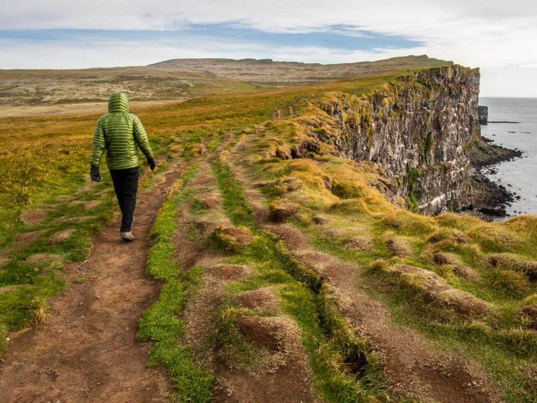 Walking along the Latrabjarg cliffs in the Westfjords, Iceland