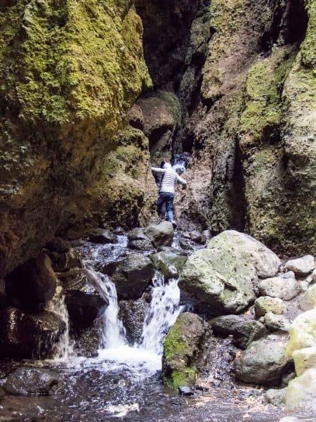 Climbing inside Rauðfeldsgjá Gorge in Snaefellness Iceland