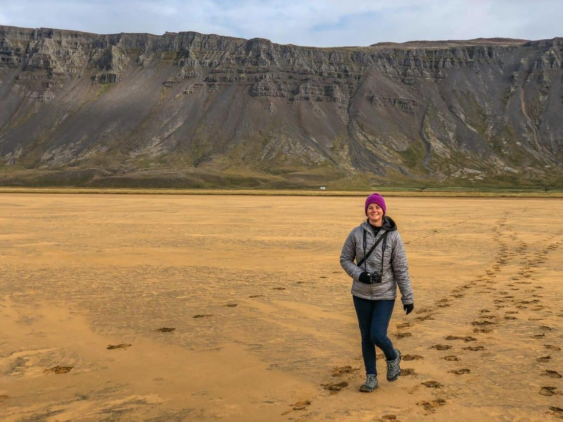 What to wear in Iceland - Erin on the red sand beach