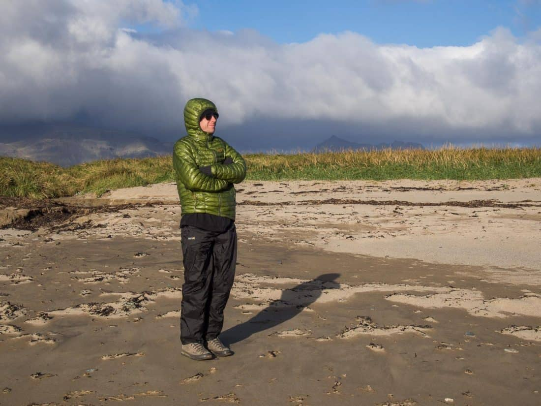 What to wear in Iceland - down jacket and waterproof trousers on Ytri Tunga beach