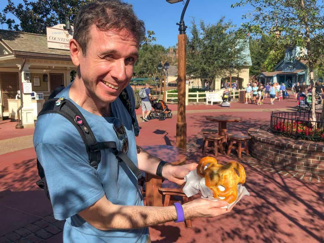 Simon with a Mickey pretzel at Disney World