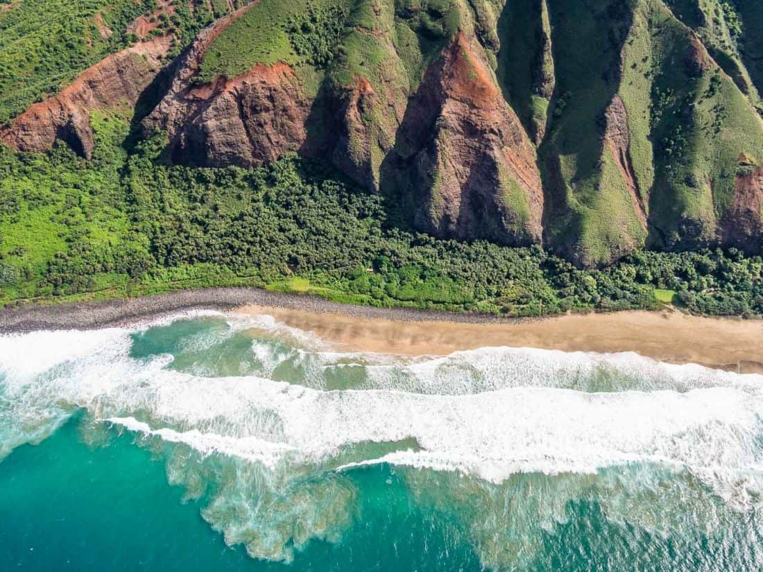 Crashing waves on a beach on the Napali coast on Kauai on a doors off helicopter tour with Jack Harter in Hawaii