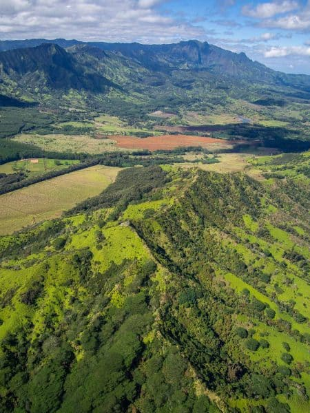Flying over the mountains of southern Kauai on our Jack Harter doors off helicopter tour