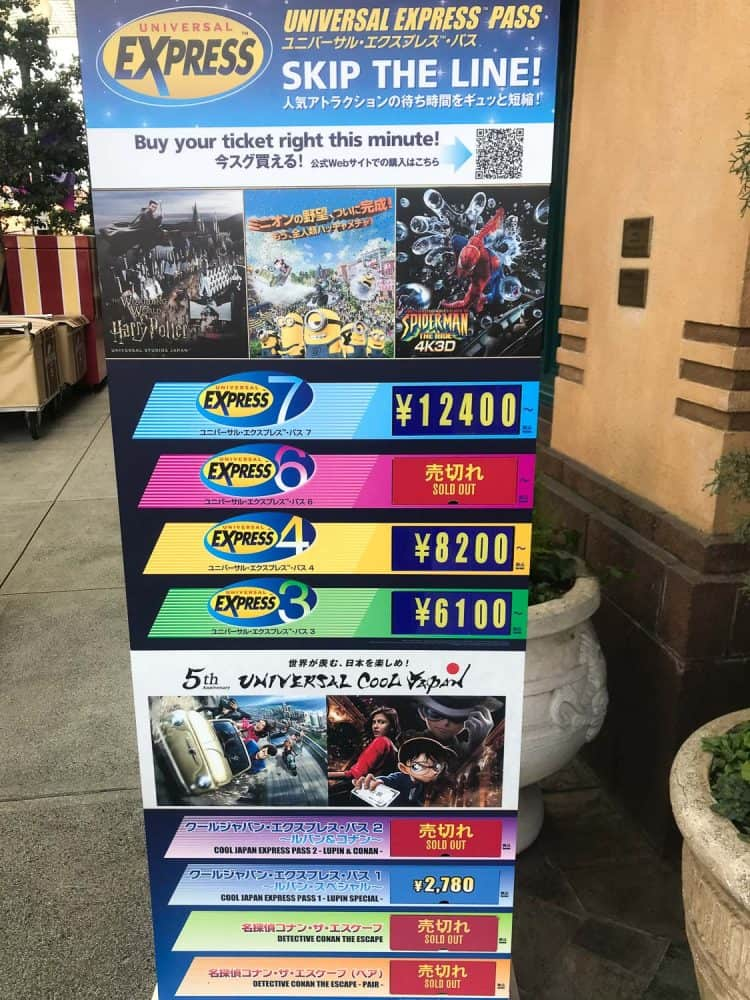 Express Pass sign in Universal Studios Japan showing the different pass options still available within the park on a visit in February