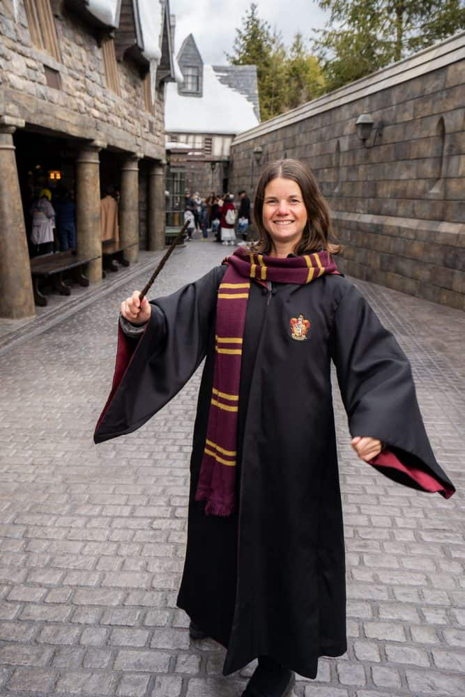 Erin dressed in Harry Potter robe and wand at The Wizarding World of Harry Potter at Universal Studios Japan in Osaka
