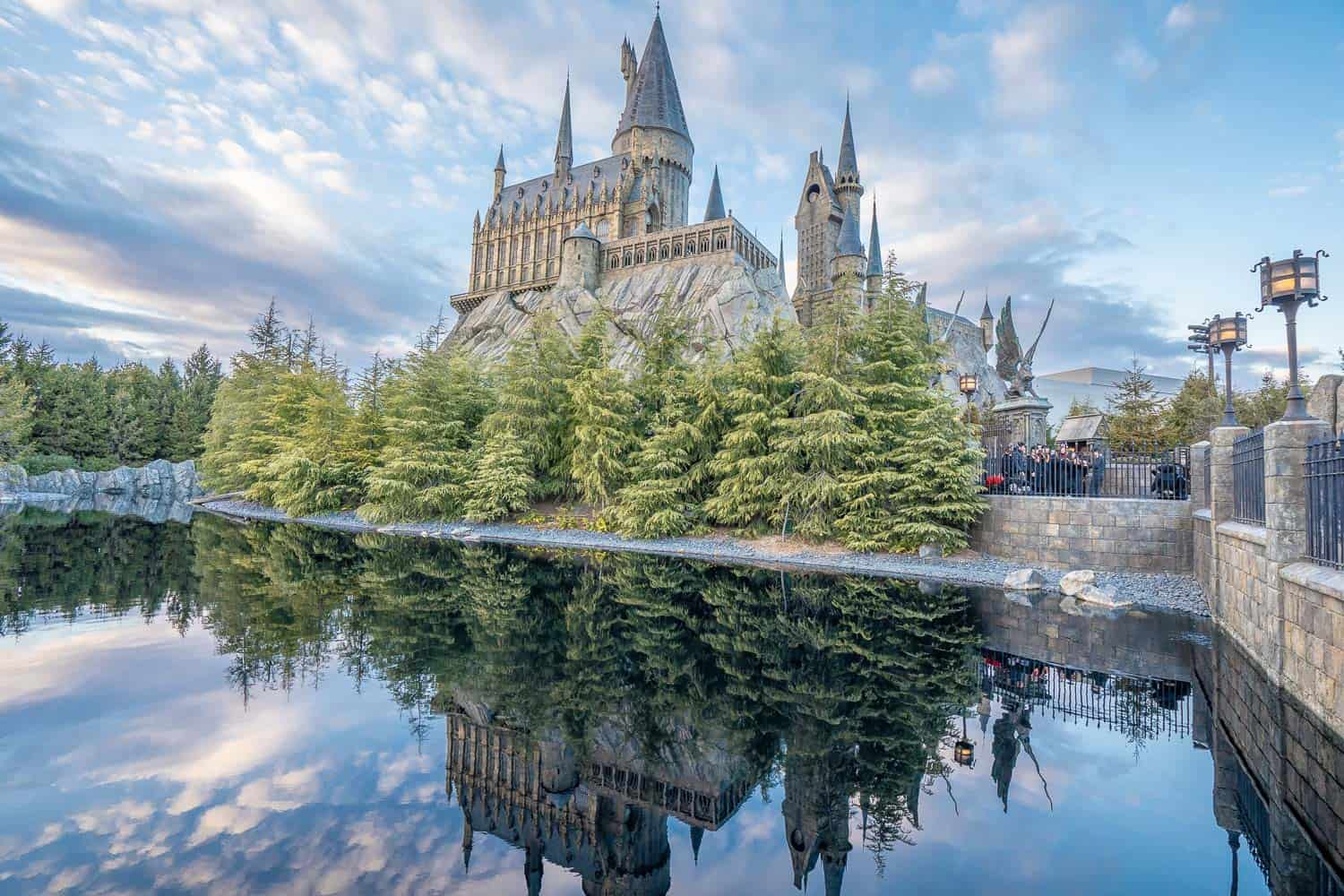 Hogwarts Castle reflected in the lake at The Wizarding World of Harry Potter at Universal Studios Japan in Osaka