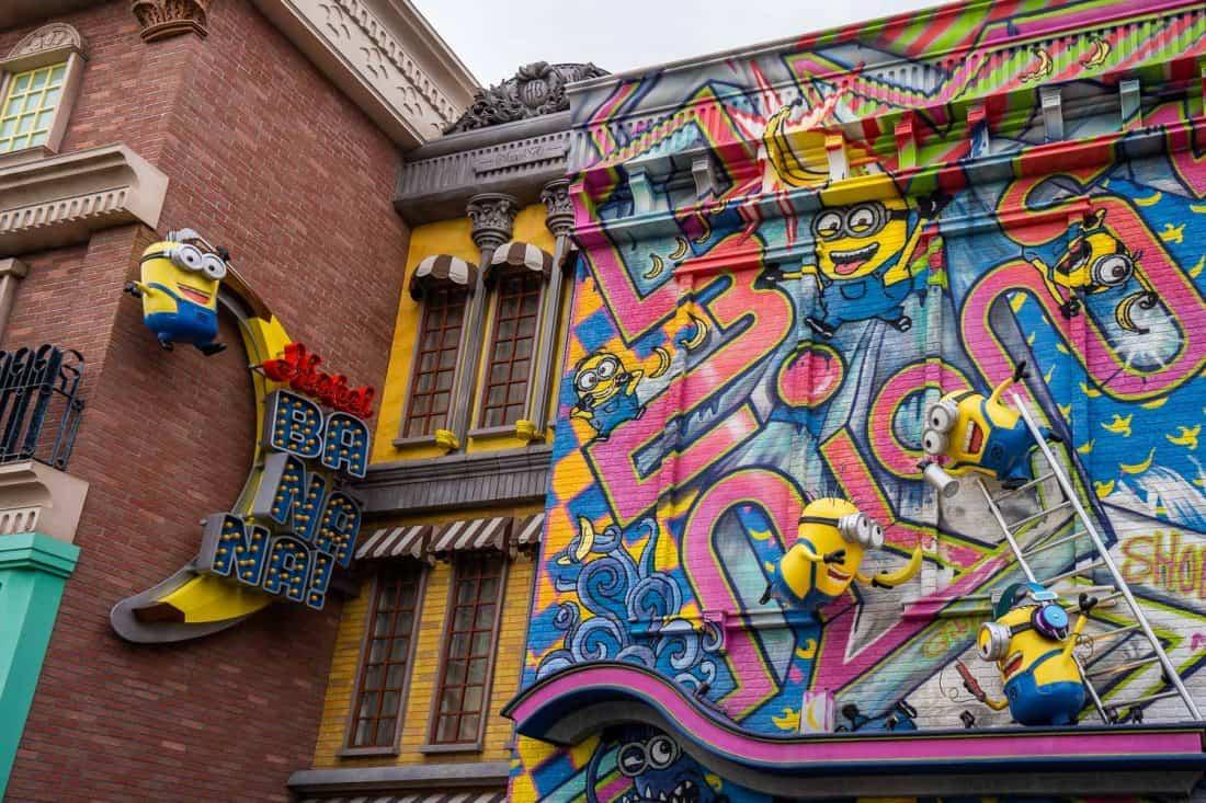 Minions climbing the graffiti wall of Hotel Banana at Minion Park in Universal Studios Japan in Osaka