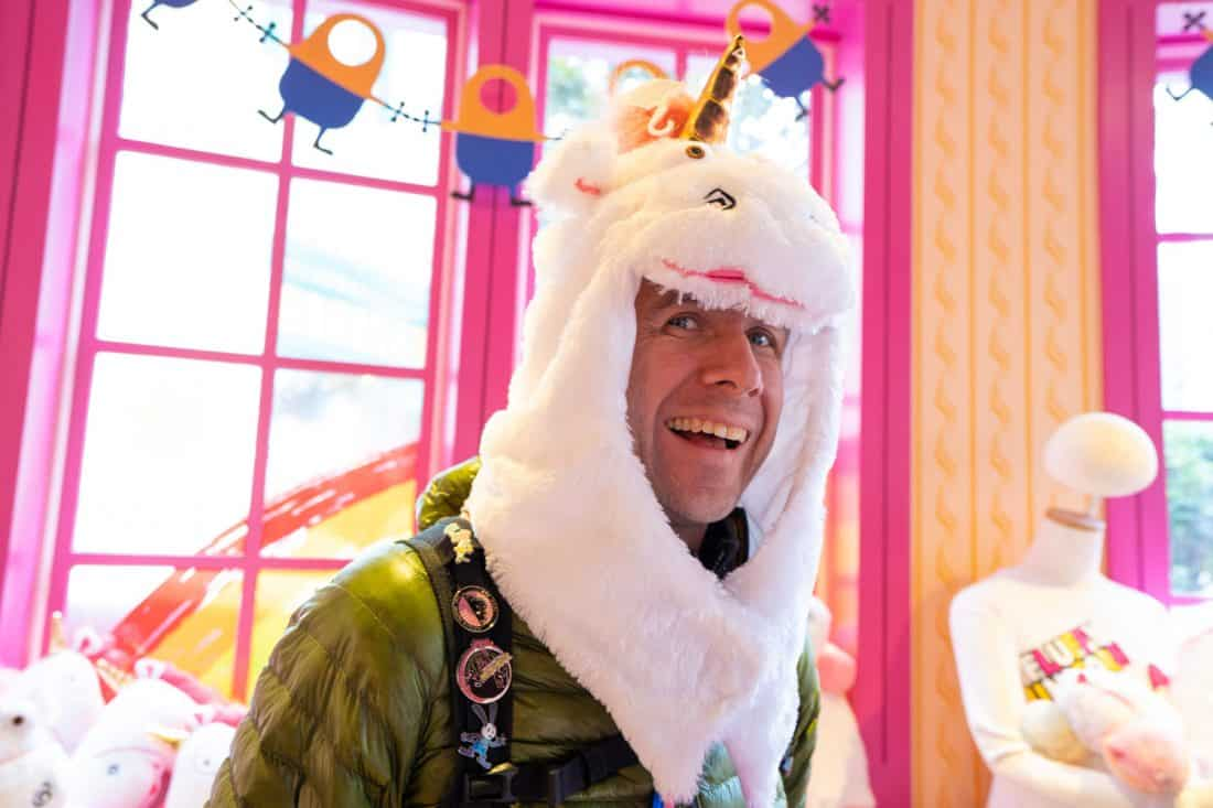 Simon in a unicorn hat at the It's So Fluffy shop in Universal Studios Japan