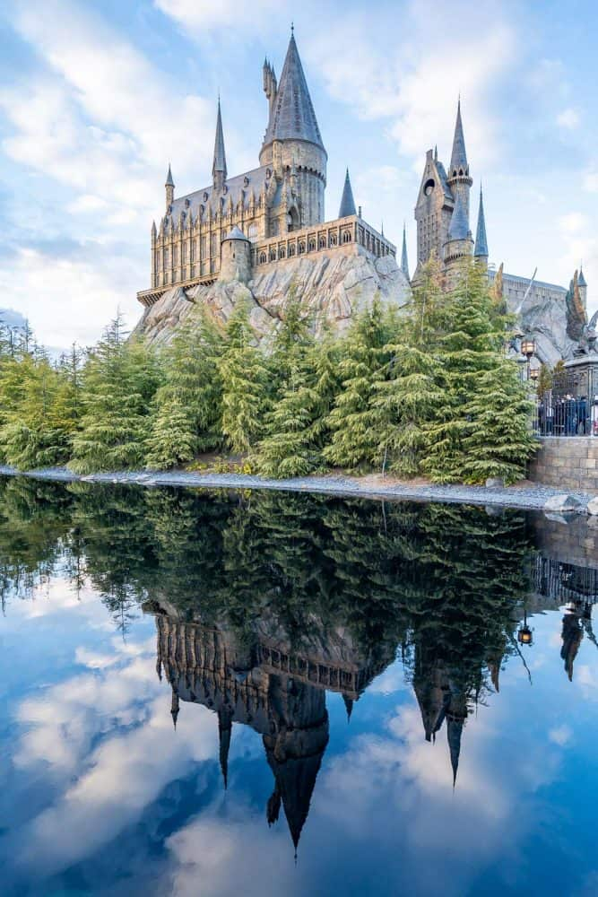 Hogwarts Castle reflected in lake at The Wizarding World of Harry Potter at Universal Studios Japan in Osaka