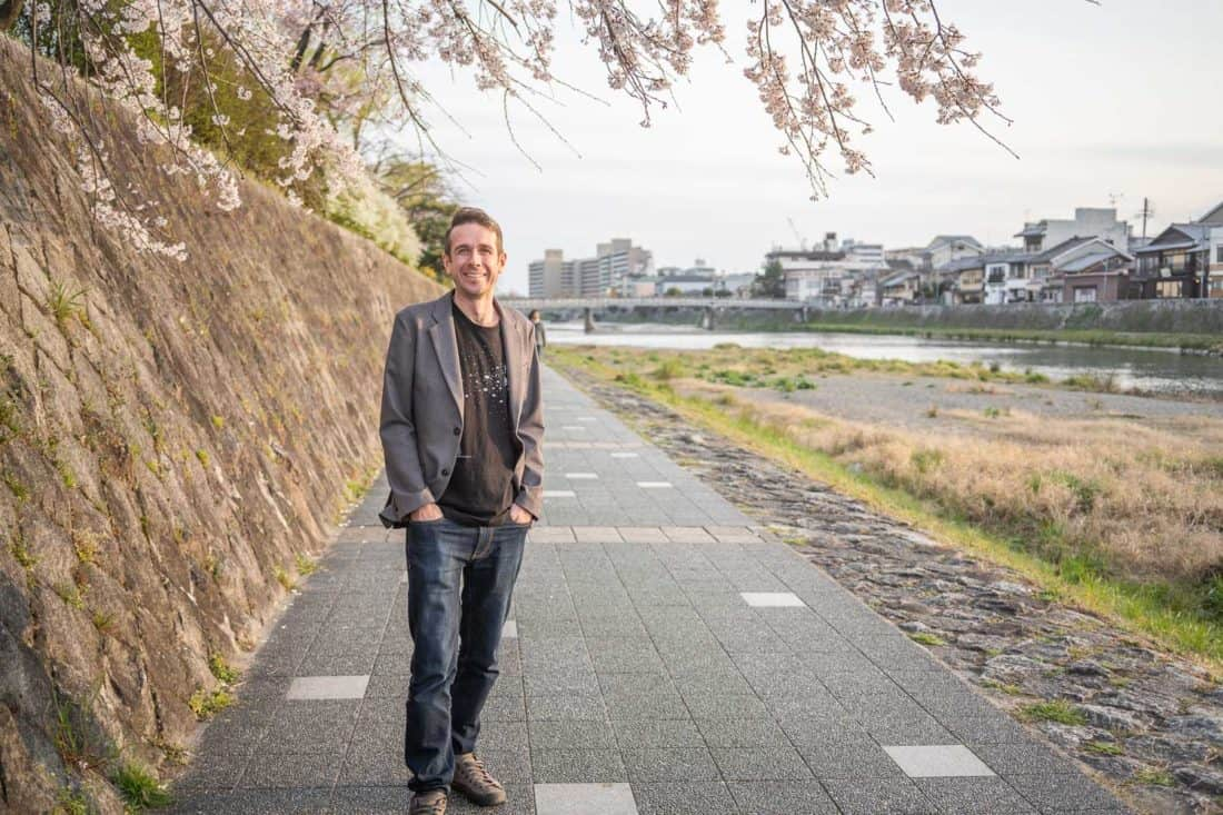 Simon wearing Bluffworks Departure jeans by the River Kamo in Kyoto