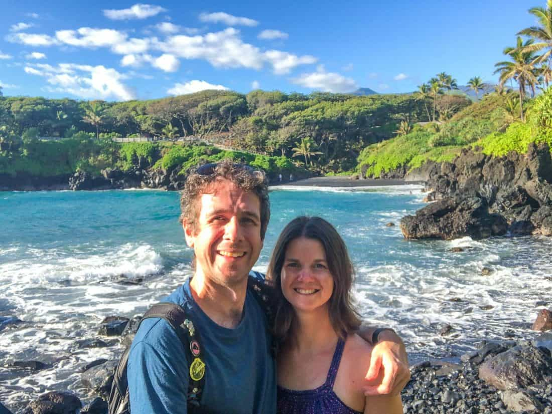 Simon and Erin at Wai'anapanapa State Park with the black sand beach in the background